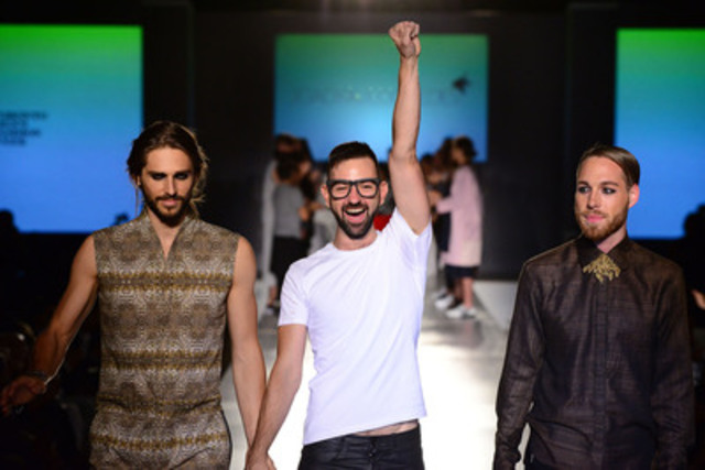 A well deserved celebratory moment for Joao Paulo Guedes after winning the 10k cash prize from The Emerging Menswear Design Awards at the first-ever Toronto Men's Fashion Week. (Photo credit: Arthur Von Tyrpa). (CNW Group/TOM, Toronto Men's Fashion Week)