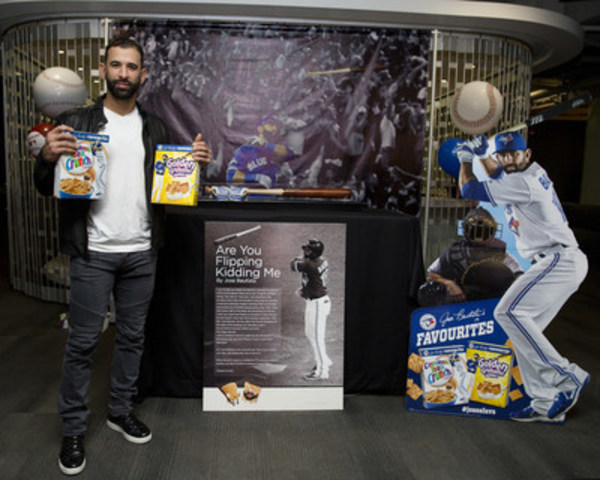 Toronto Blue Jays slugger Jose Bautista holds boxes of his favorite cereals, General Mills Cinnamon Toast Crunch and Golden Grahams Crunch. Photo By: Michelle Siu/CNW (CNW Group/General Mills Canada)