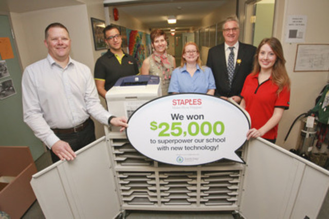 Left to right - Jasen Nyrose and Curtis Dass of Staples Canada, Susan McLeod, principal of Dewdney Elementary School, Jaime Strocel, general manager of the Mission Staples store, Randy Huth, assistant superintendent for Mission Public Schools and Meghan Warkentine of Staples Canada, check out the school's old computer equipment. Dewdney Elementary is being recognized for their eco efforts and received $25,000 worth of technology from the 2016 Staples Canada Superpower your School Contest. (CNW Group/Staples Canada Inc.)