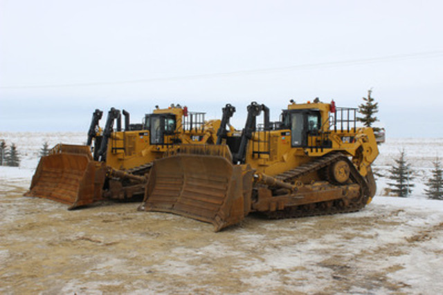 These two 2012 Caterpillar D11T crawler tractors are among the 5,350+ equipment items to be sold in Ritchie Bros. unreserved public auction in Edmonton, AB on April 23 - 25, 2014 (CNW Group/Ritchie Bros. Auctioneers)