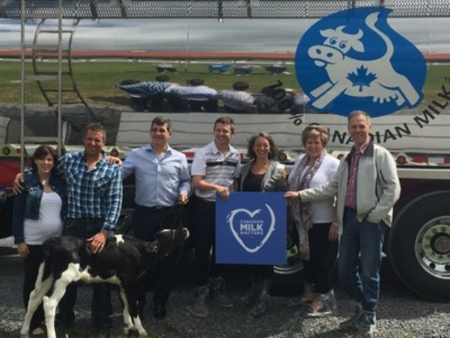 "Liberal MPs having their own #Cowmoment during a visit of Sonibrand Farms in St. Isidore, Ontario on June 6, 2016. ""I'm happy to bring my colleagues to visit a dairy farm in Glengarry-Prescott-Russell. Dairy farmers contribute greatly to the Canadian rural economy and it's important that the decision makers witness the innovation taking place in the sector,"" said Francis Drouin, Liberal MP for Glengarry-Prescott-Russell. (CNW Group/Dairy Farmers of Canada (DFC))"
