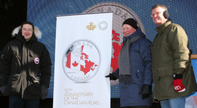 Vice-President of Human Resources and Quality Systems at the Royal Canadian Mint, Michel Boucher (right) unveils a silver collector coin commemorating the 50th anniversary of the Canadian flag. He is joined by (from left) the Honourable Pierre Poilievre, Minister of Employment and Social Development and Minister for Democratic Reform, and His Excellency the Right Honourable David Johnston, Governor General of Canada. (CNW Group/Royal Canadian Mint)