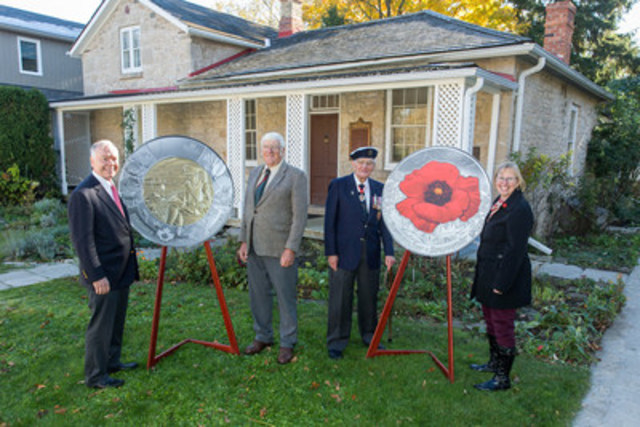 From left: John Bell, Member of the Royal Canadian Mint Board of Directors and Don Campbell, grand-nephew of John McCrae,‎ as well as The Honorable William Winegard of the Royal Canadian Legion and Bev Dietrich, Curator of the Guelph Museums, unveil a circulation coin commemorating the 100th anniversary of Lt. Col. McCrae's writing of In Flanders Fields and a new coloured poppy coin at McCrae House in Guelph, Ontario. (CNW Group/Royal Canadian Mint)