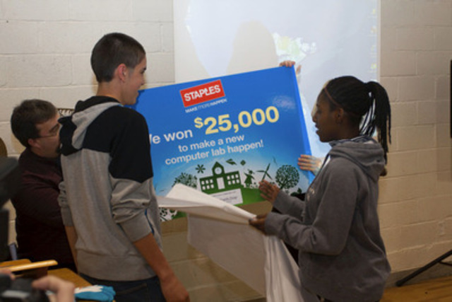 River Hebert High School students Jonathan Buboire and Sasha Zapper unveil to their school that they won a computer lab worth $25,000 in the Staples Canada Recycle for Education Computer Lab Contest. (CNW Group/Staples Canada Inc.)