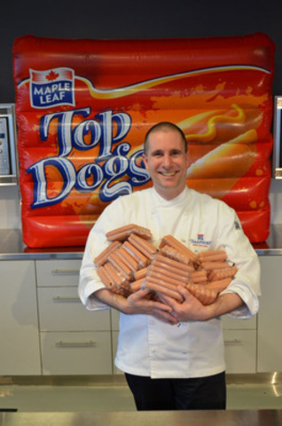 Chef and Culinary Director Bob Villeneuve with Maple Leaf Foods celebrates Maple Leaf's historic donation of four million hot dogs to food banks across Canada. (CNW Group/Maple Leaf Foods Inc.) (CNW Group/Maple Leaf Foods Inc)