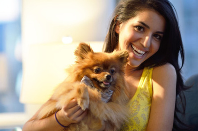 Pomeranian pooch Truffle, from Vancouver, British Columbia was declared the winning dog of the Fido Casting Call™ 2 contest with his owner Mitra Khorasani. With great support from all of the local community, Fido will donate $200,000 to the Lions Foundation of Canada Dog Guides to train and place 10 Dog Guides with Canadians with disabilities. (CNW Group/Rogers Wireless and Cable)