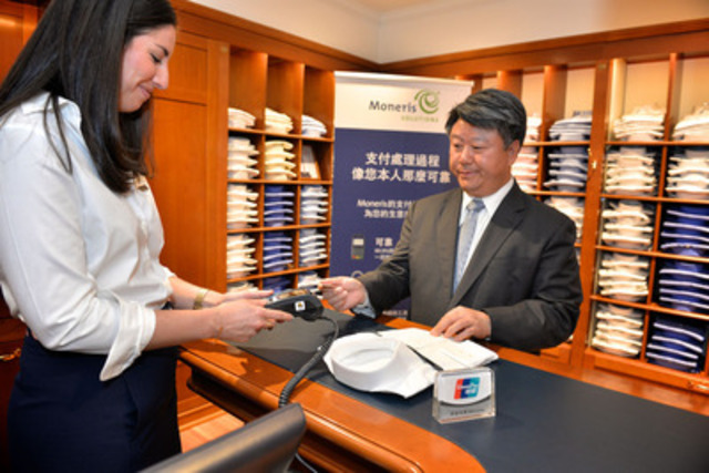Moneris and Brooks Brothers welcome Cai Jianbo, CEO of UnionPay International, as he makes the first UnionPay transaction at the Toronto flagship store. With 4.7 billion cards issued globally, UnionPay, in partnership with Moneris, opens the market to 500,000 Chinese visitors who travel to Canada each year.  (Photo Credit: Shan Qiao) (CNW Group/Moneris Solutions)
