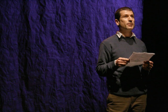 """Ayub Nuri reading his """"Letter to Canada"""" at the The Wrecking Ball 2011 political theatre event in Toronto. (CNW Group/PEN Canada)"""
