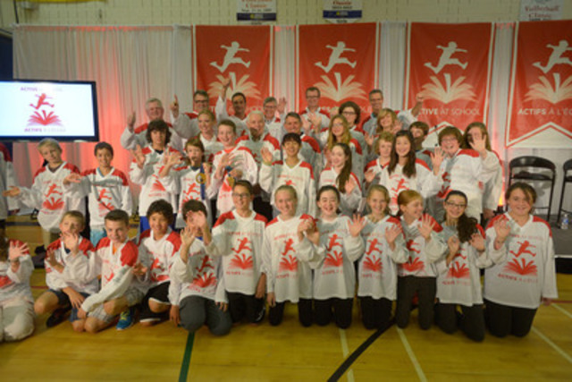 Grade 7 students at Queen Charlotte Intermediate School in PEI join Premier Robert Ghiz, Stephen Wetmore, CEO of Canadian Tire, and ACTIVE AT SCHOOL Ambassador and Olympic gold medalist, Heather Moyse to celebrate PEI's adoption of the ACTIVE AT SCHOOL movement, an initiative that champions one hour of physical activity a day for kids across Canada. (CNW Group/ACTIVE AT SCHOOL)