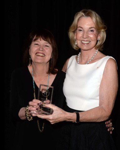 The Hon. Hilary M. Weston presents the 2015 Hilary Weston Writers' Trust Prize for Nonfiction to Rosemary Sullivan. (CNW Group/The Writers' Trust of Canada)
