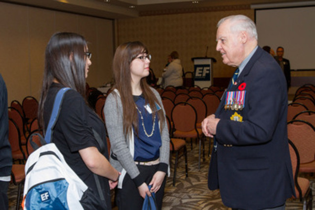 EF Educational Tours' Victory in Europe 70th Tour Launch: Student representatives Lindsay McKay and Chelsea Guindon speak with World War II veteran Stan Butterworth, of the Fort Garry Horse in Winnipeg (Photo By: Carey Tarr/EF Educational Tours) (CNW Group/EF Educational Tours)