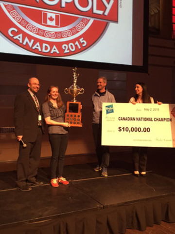 Andi Cameron is crowned 2015 Canadian MONOPOLY Champion. From left to right: Greg Ferguson, Hasbro Canada, Andi Cameron, 2015 Canadian MONOPOLY Champion, Will Lusby, 2009 Canadian MONOPOLY Champion, Julia Minicucci, Hasbro Canada (CNW Group/Hasbro Canada)