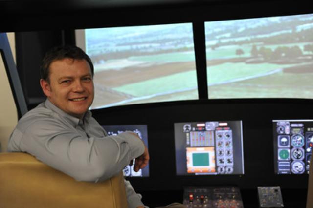 John Nicol, displaying his Griffon Helicopter Flight Simulator Design (CNW Group/Iris Dynamics Ltd.)