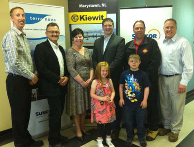 Top (left to right), Mike Dyke and Stewart Strong (Suncor), Edie Newton (The Children's Wish Foundation of Canada), and Mike Buckle, Terry Price and John Huber (Peter Kiewit Infrastructure Co.) with recently granted Wish Children, Leah Burke (L) and Ethan Hunt (R), bottom. (CNW Group/The Children's Wish Foundation of Canada)