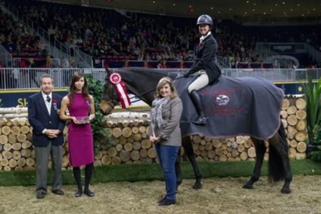 Darcy Hayes and Say When accept the top honor in the $15,000 Braeburn Farms Hunter Derby.  Photo by Mackenzie Clark (CNW Group/Royal Agricultural Winter Fair)