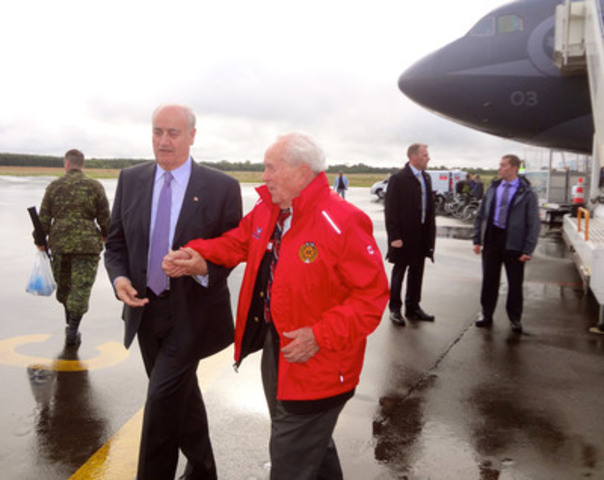 Minister of Veterans Affairs Julian Fantino, and Major-General Richard Rohmer, Senior D-Day Veteran, arrive in France. They, along with nearly 100 Canadian Veterans and 1,000 youth, will participate in commemorative ceremonies marking the 70th anniversary of D-Day. (CNW Group/Veterans Affairs Canada)