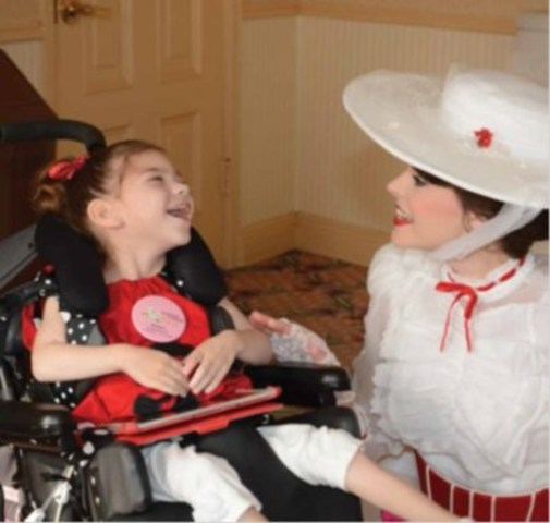 Madelyn (beside), age 6, has cerebral palsy, on her Disney Wish (with her favourite Mary Poppins)  (CNW Group/The Children's Wish Foundation of Canada)