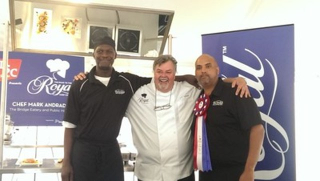Celebrity Chef, Ted Reader, congratulates the winner of a Road to the Royal challenge (CNW Group/Royal ...