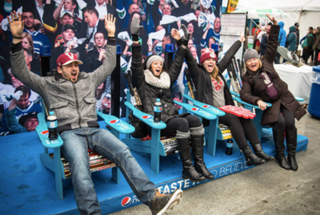 "New to Canada, Pepsi Next launched in Vancouver this past weekend with sampling teams showing up in expected places around the city giving hockey fans a chance to score tickets to the 2014 NHL Tim Hortons Heritage Classic just by sitting in the Pepsi Next ""naturally sweet seats"". (CNW Group/PepsiCo Canada)"