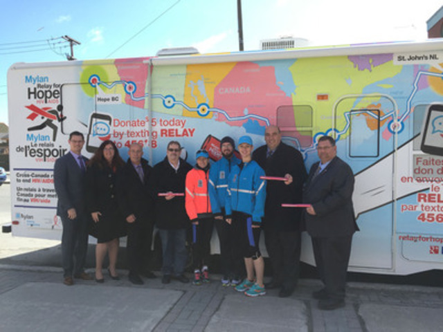 (L-R): Tim Smith (VP, Mylan Pharmaceuticals ULC), Monique Doolittle-Romas (CEO Canadian AIDS Society), Gerard Yetman (Executive Director ACNL), Philip Lundrigan (Co-Chair ACNL & Person Living with HIV/AIDS), Robyn Wright-Baker (Runner), Carey Ahr (Runner), Amanda Knebel (Runner), Paul Lane (Member of House of Assembly), Ron Ellsworth (Deputy Mayor of St. John's, NL)  (CNW Group/Mylan Pharmaceuticals)