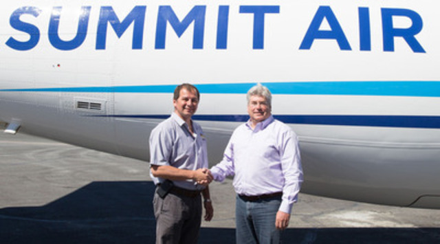 (L-R) Roy Erasmus Jr., President and CEO of Det'on Cho Corporation and Rob Mauracher, President, Summit Air Group in Yellowknife, June 16, 2014. (CNW Group/Summit Aviation)