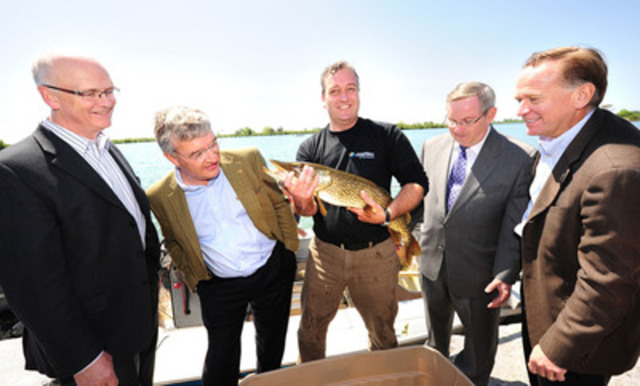 Brian Denney, CEO of Toronto and Region Conservation, Nicola Kettlitz, President, Coca-Cola Ltd., Rick Portiss, Manager, Restoration and Environmental Monitoring, Toronto and Region Conservation, Hon. Jim Bradley, Minister of the Environment, Government of Ontario and John Guarino, President, Coca-Cola Refreshments Canada with their big catch at Tommy Thompson Park on the Leslie Street Spit. Toronto and Region Conservation and Coca-Cola Canada have partnered to restore nine hectares of the Park into a flourishing coastal wetland. (CNW Group/Coca-Cola Canada)