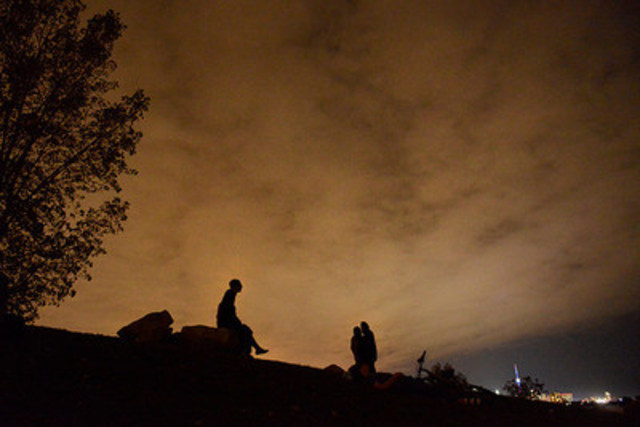 Marta Iwanek, the recipient of the 2015 Tom Hanson Photojournalism Award, captured this image of cloud cover obscuring the view of the blood moon eclipse in Humber Bay Park in Toronto on September 27. Applications are now being accepted for the award. Deadline: January 7, 2016. THE CANADIAN PRESS/Marta Iwanek (CNW Group/Canadian Journalism Foundation)
