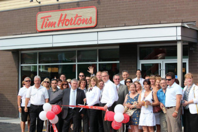 Tim Hortons newest franchisee's Chris and Lisa Stopay officially open the restaurant's 500th Quebec location in St. Adèle (CNW Group/TIM HORTONS INC.)
