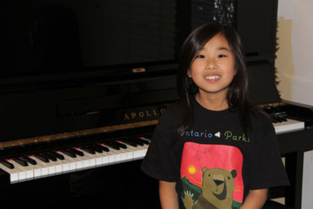 Chloe Huang, one of two talented children from Toronto's Regent Park community selected by the Toronto Symphony Orchestra and CIBC to participate in a performance with world-renowned classical pianist Lang Lang. (CNW Group/CIBC)