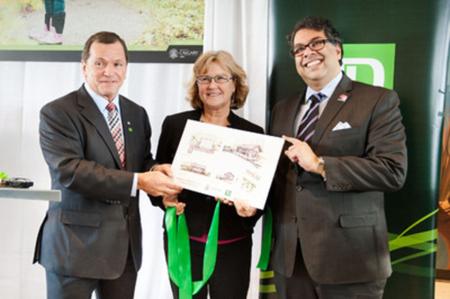 Frank McKenna, Deputy Chair, TD Bank Group presents Calgary Mayor Naheed Nenshi and Anne Charlton, Parks Director, with a rendering of a future outdoor classroom at the Inglewood Bird Sanctuary. TD announced a $500,000 gift to the City today for the classroom and to restore flood damage, along with a commitment to sponsor the City's new Litter Cleanup Program. (CNW Group/TD Bank Group)