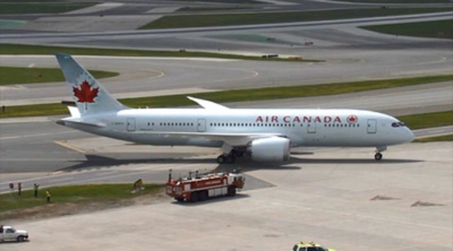 Video: Air Canada's first 787 Dreamliner lands and receives a water cannon salute at Toronto's Pearson Airport, Sunday May 18, 2014.