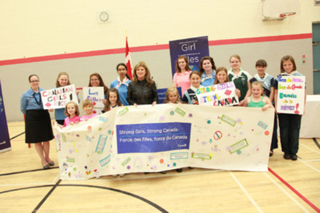 In this picture: The Honourable Rona Ambrose, Minister of Public Works and Government Services and Minister for Status of Women accompanied by Ms. Sarah Govan, Board member of Girl Guides Canada, and local Girl Guides at an announcement in Ottawa last spring. (CNW Group/Status of Women Canada)