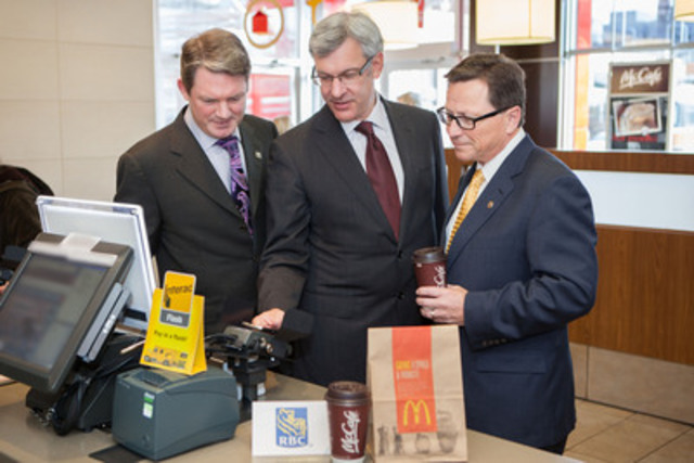 Today marked the successful completion of the first Near Field Communication (NFC) mobile debit transaction in Canada, and among the first globally from a domestic debit network. Left to right: Mark O'Connell, President and CEO, Interac Association and Acxsys Corporation; Dave McKay, Group Head, Personal and Commercial Banking, RBC Royal Bank; Dave Hederson, Senior Vice President & CFO, McDonald's Restaurants of Canada Limited. (CNW Group/Interac Association)
