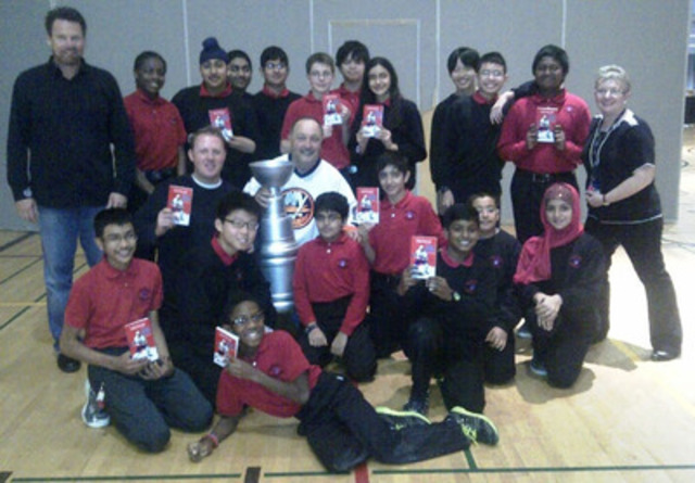 NHL Hall of Famer Bryan Trottier and well-known Canadian author Sigmund Brouwer (standing on left) with students and staff from North Kipling Junior Middle School in Toronto. (CNW Group/National Bank of Canada)