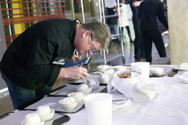 Jury member Michael Howell examines entries in one of the 27 cheese categories in the prestigious 2015 Canadian Cheese Grand Prix competition, hosted by Dairy Farmers of Canada. Eighty one category finalists were selected and the Grand Champion cheese will be announced April 22 in Toronto (CNW Group/Dairy Farmers of Canada (DFC))