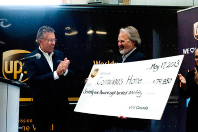 Michael Tierney, President, UPS Canada presents Martin Riley, President, Carmelina's Home with USD$79,850 ...