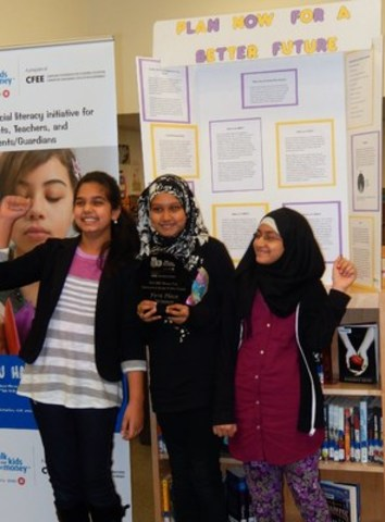 To celebrate November as Canada's Financial Literacy Month, Sprucecourt Public School in Toronto staged a Money Fair for its grade 5/6 students. The members of the winning team are Raima Absara, Maiesha Kanieze and Shiza Arshad (CNW Group/Canadian Foundation for Economic Education)