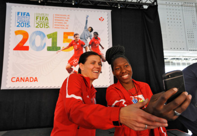 Christine Sinclair and Kadeisha Buchanan take a 'selfie' with FIFA Women's World Cup Canada 2015 stamp (CNW Group/Canada Post)