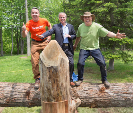 Ian Cunningham, COO, Tangerine, Moncton Mayor George H. LeBlanc and Adam Bienenstock, Founder and Principal Designer, Bienenstock Playgrounds, tested out a new log seesaw in Centennial Park. More than 150 Tangerine employees and community volunteers participated in the one-day playground build to give Moncton area residents a #BrightWayForward. (CNW Group/Tangerine)