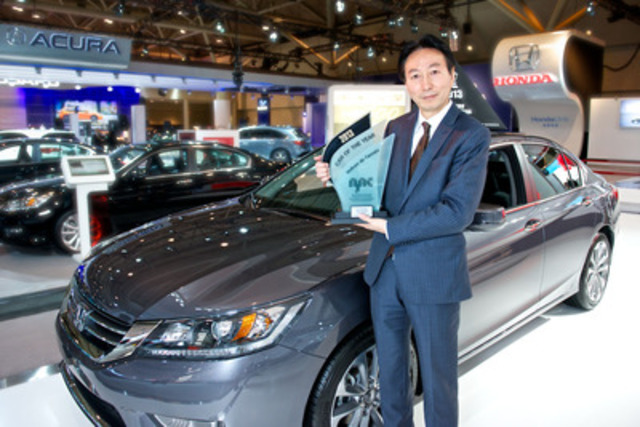 Honda Canada President and CEO, Takashi Sekiguchi, accepts the Automobile Journalist Association of Canada's 'Car of the Year' award for the 2013 Honda Accord Sedan. (CNW Group/Honda Canada Inc.)