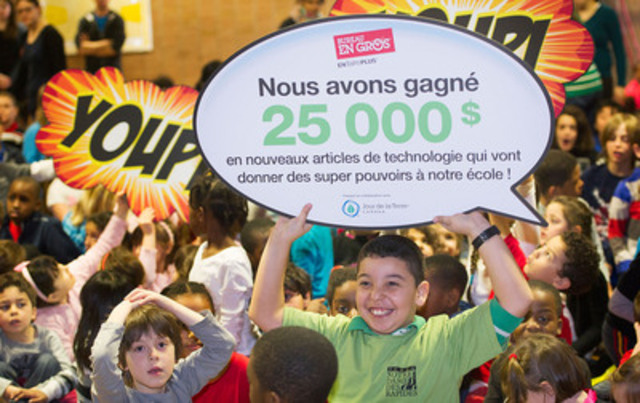 Students from Ecole Notre-Dame-des-Rapides in Lasalle celebrate after winning $25,000 worth of technology for their environmental efforts.  The school was 1 of 2 schools in Quebec to win in the Staples Superpower your School Contest. (The Canadian Press Images) (CNW Group/Staples Canada Inc.)