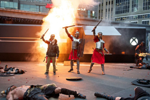 Roman legionnaires do battle with barbarians at the colossal Xbox One. The console appeared in Yonge-Dundas Square yesterday, the third stop of its launch tour after Vancouver and Montreal. The Xbox Live community unlocked the Ryse: Son of Rome battle by pledging their gamertags to the One Source project. (CNW Group/XBOX CANADA)