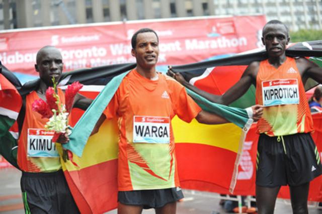 Ethiopia's Sahle Warga (centre) finishes first at the Scotiabank Toronto Waterfront Marathon (2:10:35) followed by Kenyan runners Kiplimo Kimutai (2:11:20) and John Kiprotich (2:11:29). Photo credit: Todd Duncan. (CNW Group/Scotiabank - Sponsorships & Donations)
