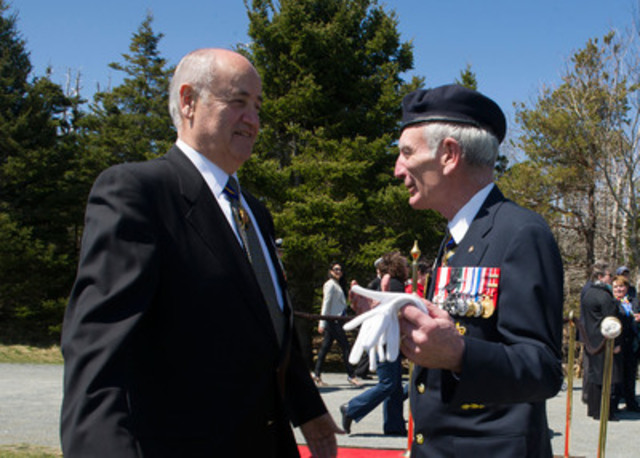The Honourable Julian Fantino, Minister of Veterans Affairs, speaks with Grand President of the Royal Canadian Legion, Vice Admiral Larry Murray, C.M., C.M.M, C.D. (Ret'd), following the 71st anniversary of the Battle of the Atlantic Ceremony, in Halifax. Minister Fantino was in Halifax to commemorate the sacrifices made by the thousands of Canadians who fought so valiantly in the North Atlantic during the Second World War. (CNW Group/Veterans Affairs Canada)
