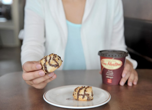 Tim Hortons introduces its first menu item certified by the Canadian Celiac Association Gluten-Free Certification Program. The Tim Hortons Gluten-Free Coconut Macaroon is a delicious meringue-style cookie made with real coconut and drizzled with milk chocolate. It's available in a pre-wrapped two-piece package at all Tim Hortons restaurants for $1.29. (CNW Group/Tim Hortons)