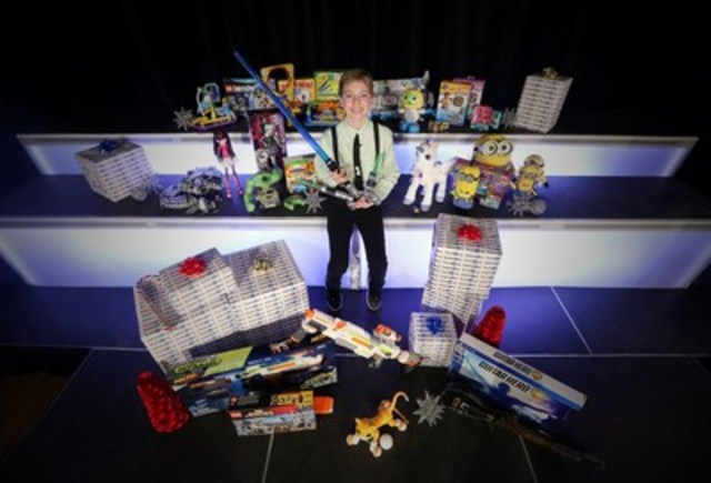 "Toys""R""Us, Canada's Chief Play Officer, Alex Thorne, unveils the 2015 Holiday Hot Toy List featuring the 20 most popular toys that will be at the top of every kid's wish list this year. (CNW Group/Toys ""R"" Us (Canada) Ltd.)"