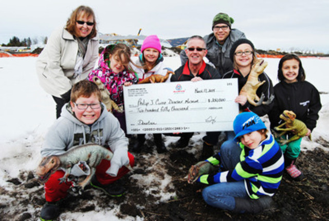 Alliance Pipeline's Grande Prairie Area Manager, Trevor Loberg, visited the Philip J. Currie Dinosaur Museum construction site to present a cheque for $250,000. Grade Four students from Wembley Elementary School were there to receive it on behalf of all the students who will benefit from the Museum. (Photo: Erika Sherk) (CNW Group/Alliance Pipeline Limited Partnership)