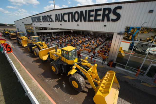 A selection of wheel loaders crosses the Ramp on Day Two of the Ritchie Bros. Orlando, FL auction (Feb 18 - 23, 2013) (CNW Group/Ritchie Bros. Auctioneers)