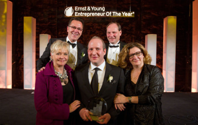 From left, clockwise - National judges Ginny Dybenko, University of Waterloo, Jim Case, Travelers Financial Group, Kevin Wolfe, Richard Equity Management Ltd., Andrée-Lise Methot, Cycle Capital Management, with National Entrepreneur Of The Year Dani Reiss, Canada Goose. (CNW Group/Ernst & Young)