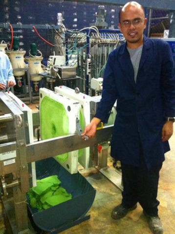 Pilot Plant Metallurgist Vito Andada demonstrates the production of NHP from a filter press at the Agata Nickel  ...